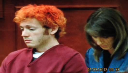 James Holmes with public defender Tamara Brady at his first court hearing in July 2012. (Hill 'n Holler staff photo from pool video by KUSA TV)