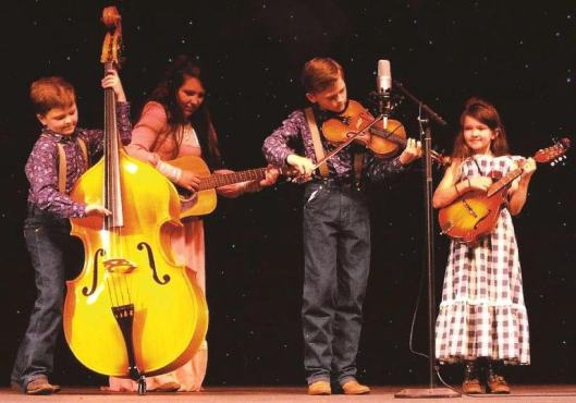 The Baker Family -- Elijah, Carrie, Trustin and Carina -- play at Silver Dollar City in Branson, Mo.