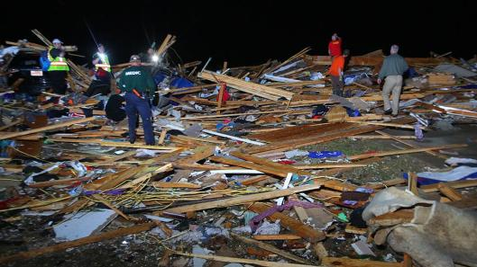Rescuers search for survivors in the wreckage of homes in a subdivision where fatalities occurred in Vilonia, Ark., after a tornado struck there April 27. (Weather Channel photo by Stephen B. Thornton)