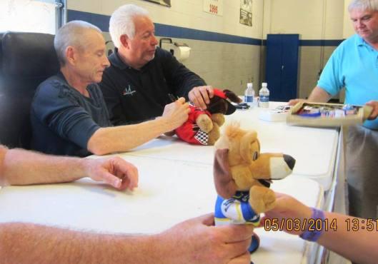 Mark Martin autographs some stuffed animals. (Staff photo by Caroll Lucas)