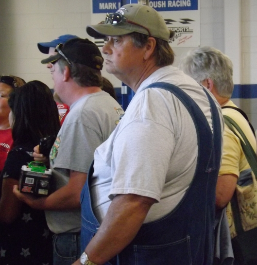 A fan from Branson, Mo., Bob Craig, waits in line for a Danica autograph. (Staff photo by Mariann Hyslop)
