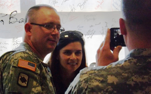 Danica signs autographs and poses with the military