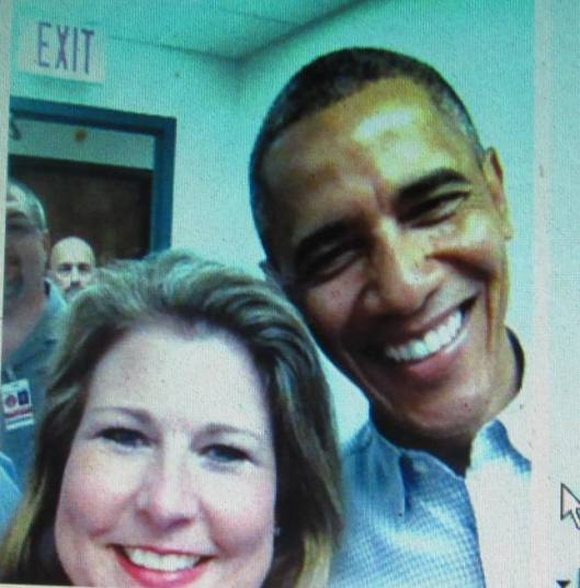 President Obama with one of the volunteers.