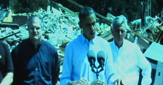 President Barack Obama speaks at the conclusion of his visit to Vilonia, Ark. Behind him are U.S. Sen. Mark Pryor and Arkansas Gov. Mike Beebe.