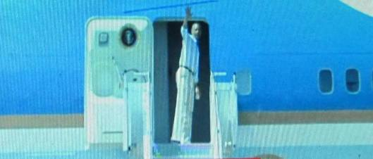 President Obama boards Air Force One to leave for California.