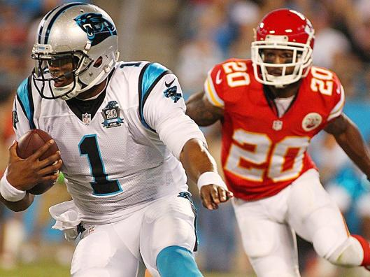Panther quarterback Cam Newton is trailed by Chiefs cornerback Chris Owens. (Kansas City Chiefs photo)