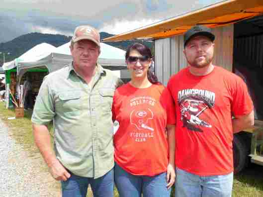 """Moonshiner Mike """"Mud Dog"""" Mitchell (Discovery's """"Moonshiners"""") mingles with fans Mandie and Will Sutton of Bullock Creek, South Carolina."""