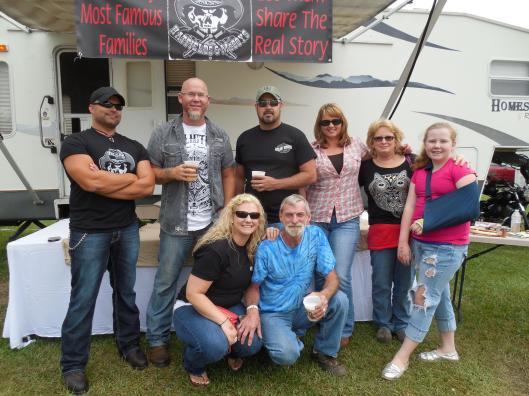 Fans mingle with the REAL Hatfields and McCoys. That's Shane McCoy in the top row, far left, next to James Hatfield.