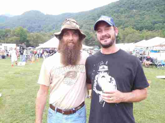 """Greg Shook of The History Channel's """"Appalachian Outlaws"""" (left) greets a fan, Shane Robinson of Asheville, North Carolina."""