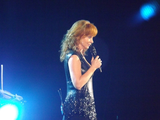 Reba McIntire in a reflective moment of her high energy performance. (Hill 'n Holler staff photo by Mariann Hyslop)