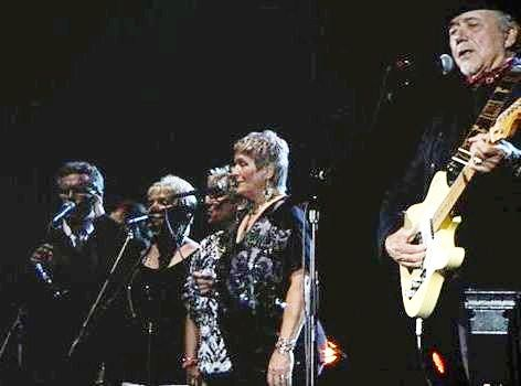 Members of the Rhodes Family sing backup for Bobby Bare. (Facebook photo)