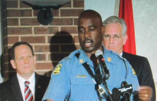 Highway Patrol Capt. Ron Johnson speaks to reporters Thursday afternoon. He soon afterwards joined protesters in their march in Ferguson.