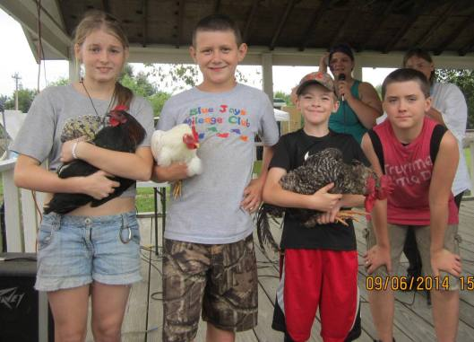 The Chicken Chase for kids is among the most popular events of the day. (Hill 'n Holler sraff photo)