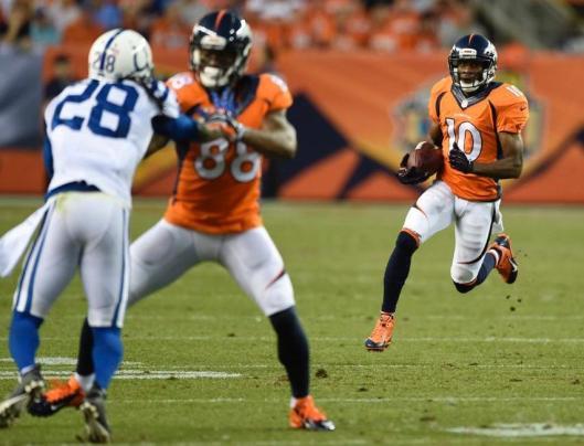 Bronco wide receiver Emmanuel Sanders runs with the ball.  (Denver Broncos photo)