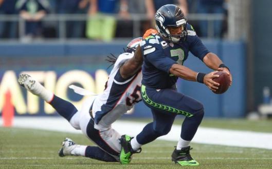 Bronco linebacker Nate Irving sacks Seahawk quarterback Russell Wilson (Denver Broncos photo)