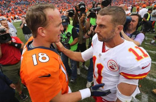 Broncos quarterback Peyton Manning and Chiefs quarterback Alex Smith after the game Sunday. (Denver Broncos photo)