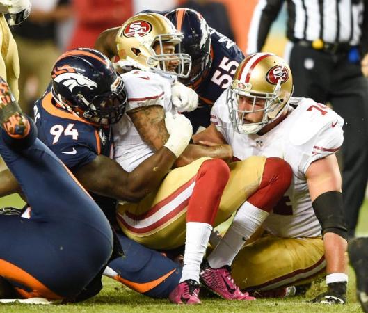 Bronco DeMarcus Ware sacks 49ers quarterback Colin Kaepernick. (Denver Broncos photo)