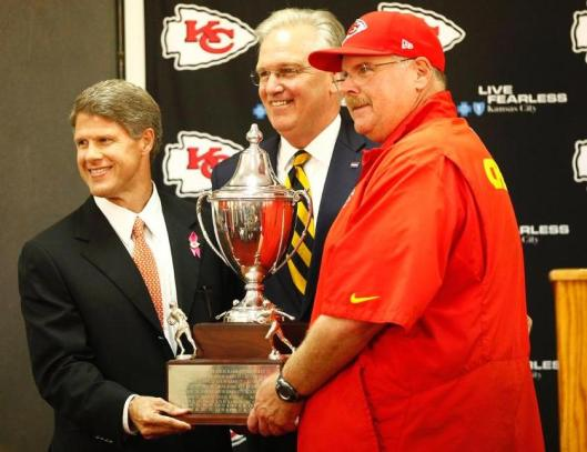 Clark Hunt and Andy Reid are presented with the 2014 Governor's Cup by Missouri Gov. Jay Nixon.  (Kansas City Chiefs photo)