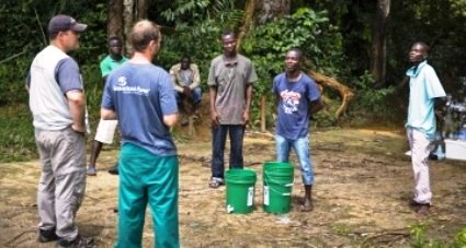 Samaritan's Purse staff members Nathan Glancy and John Troke take infection protection and control kits to a village in Grand Bassa county affected by Ebola.  (Samaritan's Purse photo)