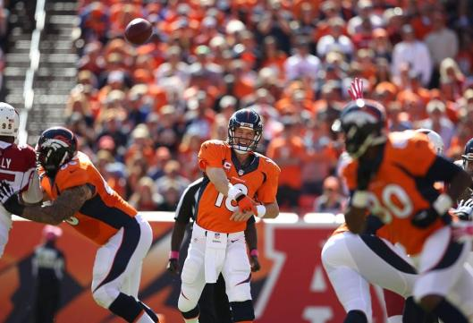 Broncos quarterback Peyton Manning threw his record 500th touchdown pass Sunday in the first drive of the game against the Arizona Cardinals. He had a career high 479 passing yards and threw three more touchdowns. (Denver Broncos photo)