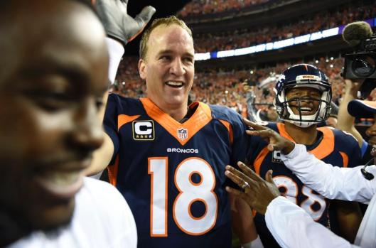 Broncos quarterback Peyton Manning  is congratulated after throwing his record setting 509th touchdown in the game against the San Francisco 49ers Sunday night.  (Denver Broncos photo)