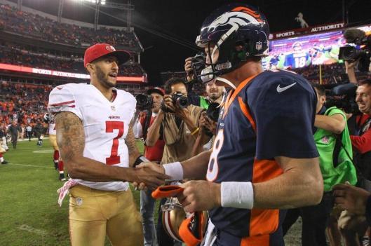 Colin Kaepernick congratulates Peyton Manning Sunday. (Denver Broncos photo)