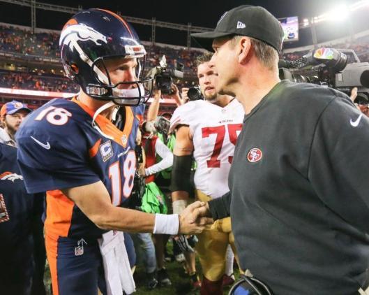 Peyton Manning is congratulated by San Francisco Head Coach Jim Harbaugh (Denver Broncos photo)