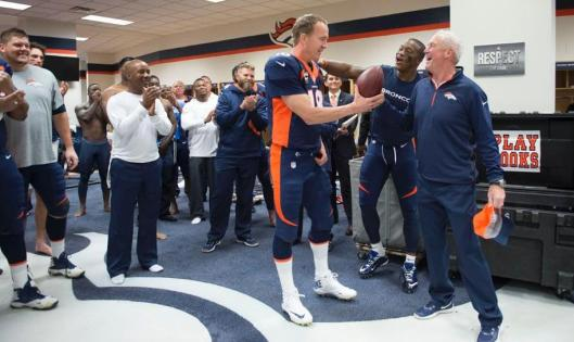Peyton Manning is joined in the after-game celebration by Demaryius Thomas and Denver Head Coach John Fox. (Denver Broncos photo)
