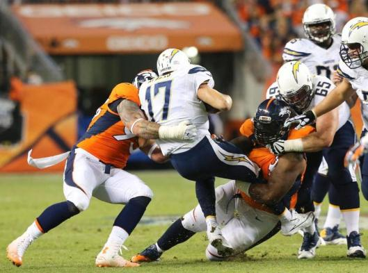 Chargers quarterback Philip Rivers gets sacked by the Broncos. (Denver Broncos photo)