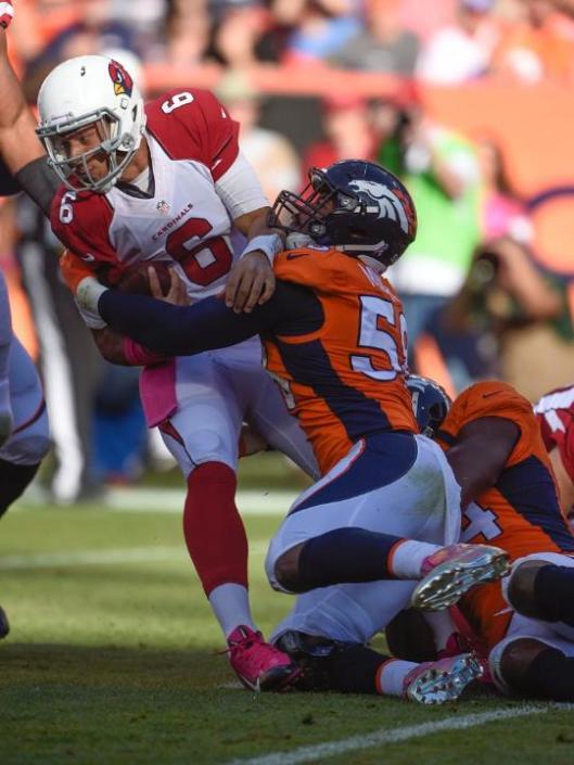 On the Broncos roster for the first time this season, Danny Trevathan sacks backup Cardinal quarterback Thomas Logan. (Denver Broncos photo)