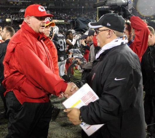 Chiefs Head Coach Andy Reid congratulates Raiders interim Head Coach Tony Sparano. (Oakland Raiders photo)