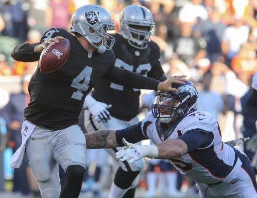 Bronco defensive end Derek Wolfe goes after Raider quarterback Derek Carr. (Denver Broncos photo)