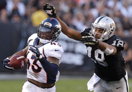Bronco strong safety T.J. Ward intercepted the ball in the third quarter Sunday. (Denver Broncos photo)