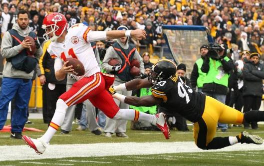 Chiefs quarterback Alex Smith ran twice Sunday for 14 rushing yards. Smith threw 31 completed passes for 311 yards. (Kansas City Chiefs photo)