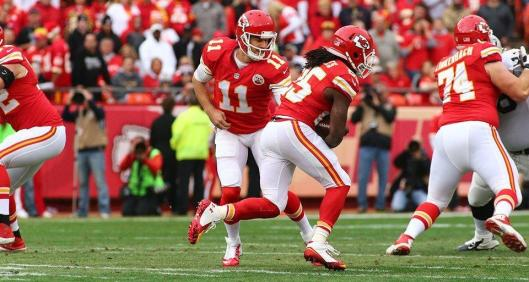 Chiefs quarterback Alex Smith hands the ball to running back Jamaal Charles, who led Kansas Cith in rushing with 12 carries for 53 yards. (Kansas City Chiefs photo)