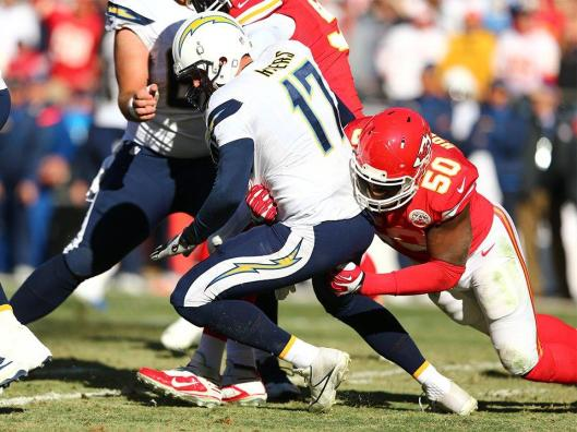 Chiefs linebacker Justin Houston sacks Chargers quarterback Philip Rivers. Houston sacked Rivers four times Sunday and broke the Chiefs season record with a total of 22 sacks. (Kansas City Chiefs photo)