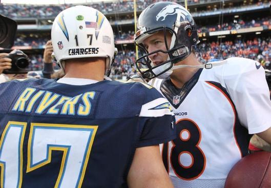 Chargers quarterback Philip Rivers talks to Broncos quarterback Peyton Manning Sunday. (Denver Broncos photo)