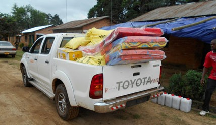 A truck transporting solidarity kits containing essential supplies for Ebola survivors returning home in the Firestone District of Liberia (CDC Photo)