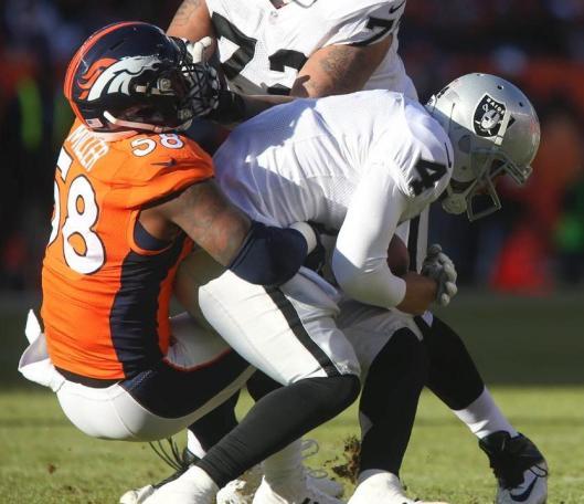 Bronco linebacker Von Miller sacks Raider quarterback Derek Carr. Carr was sacked three times Sunday. (Denver Broncos photo)