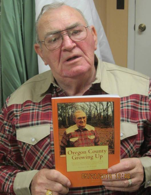 """Bill Combs and his book """"Oregon County Growing Up""""  (Hill 'n Holler staff photo)"""