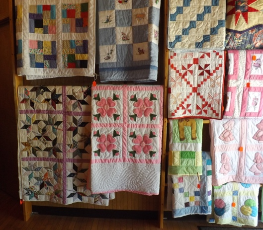 Quilts on display and for sale at the welcome center