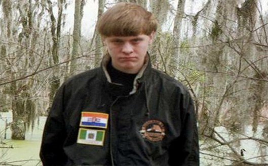 A Facebook photo of Dylann Roof showing him wearing a jacket with patches of the racist era flags of South Africa and Rhodesia