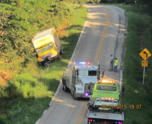 This contract  mail truck overturned in a ditch on V Highway near Jeff, Mo., Saturday afternoon.  The truck was believed to be returning from its run to the Myrtle, Mo., Post Office. (Hill 'n Holler staff photo)