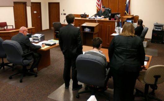 Nicholas Godejohn's attorneys -- public defenders Dwayne F. Perry and Stephanie J. Bullard -- address Judge J. Ronald Carrier (Pool photo - Nathan Papes/Springfield News-Leader)