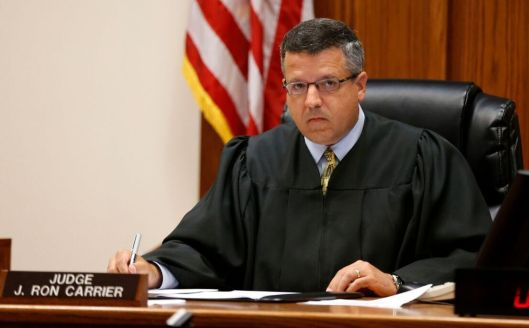 Judge J. Ronald Carrier presides over the arraignment of Nicholas Godejohn (Pool photo - Nathan Papes/Springfield News-Leader)