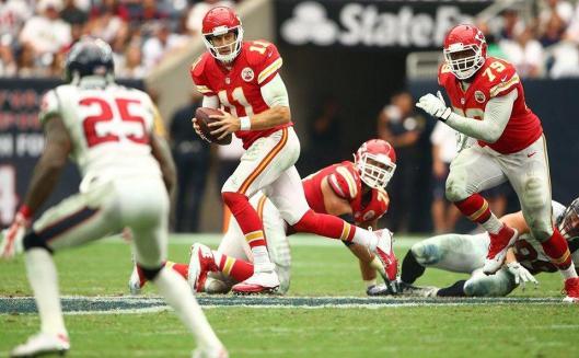 Chiefs quarterback Alex Smith runs with the ball. (Kansas City Chiefs photo)