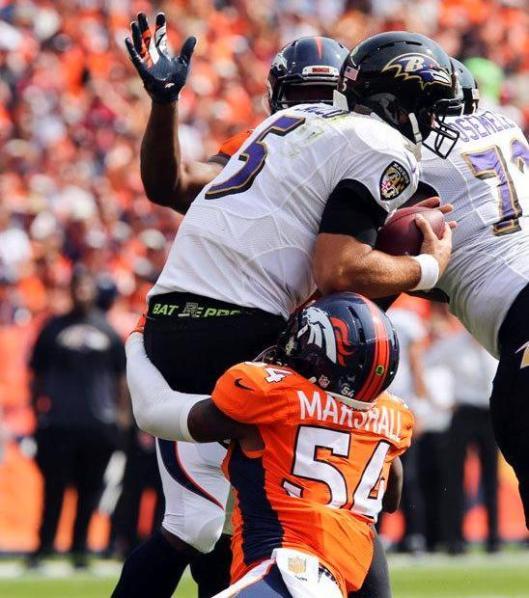 Ravens quarterback Joe Flacco gets sacked. (Denver Broncos photo)
