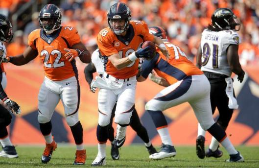 Bronco quarterback Peyton Manning runs with the ball Sunday. (Denver Broncos photo)