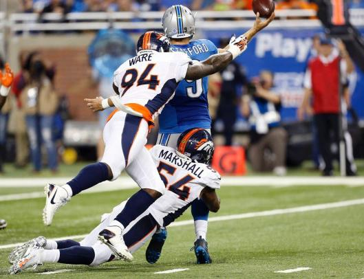 Lions quarterback Matthew Stafford is sacked by DeMarcus Ware and Brandon Marshall. (Denver Broncos photo)