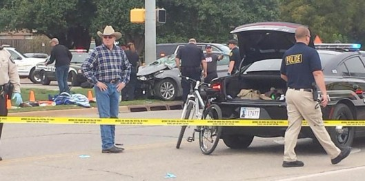 The car in the background , a Hyandai Elantra, caused four deaths and numerous injuries during the Oklahoma State University homecoming parade.  (Twitter photo from Geoff Haxton)